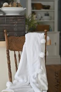 DIY chenille blanket with pom poms