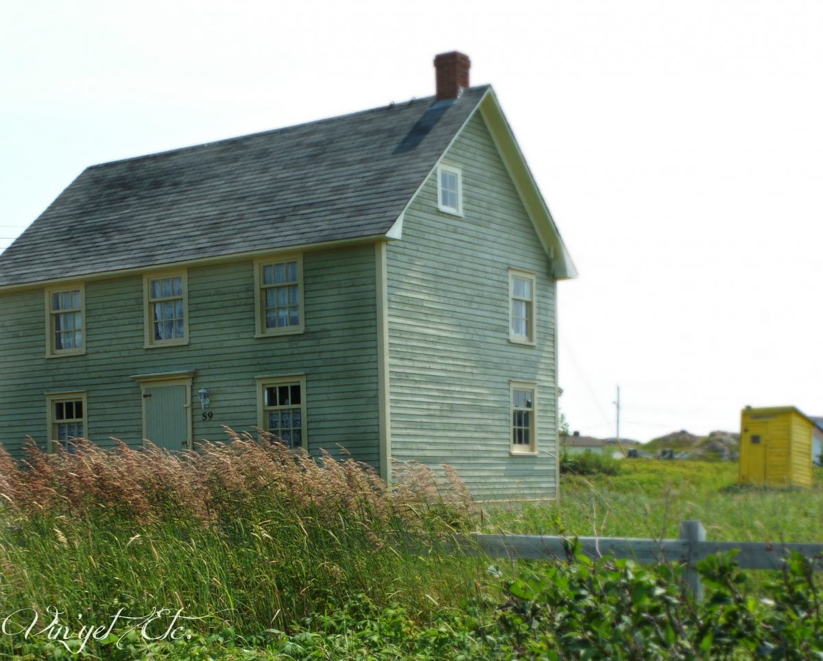 Newfoundland House with pretty yellow Outhouse